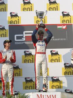 Nico Muller celebrates victory on the podium with Esteban Gutierrez