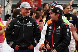 Michael Schumacher, Mercedes GP and Timo Glock, Virgin Racing