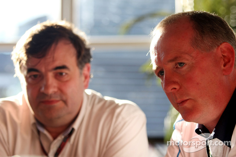Tim Routsis and Mark Gallagher, General Manager of Cosworth's F1 Business Unit talk to the media