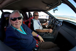 Motorsport.com's Nancy Knapp Schilke in a VIP ride with Hurley Haywood