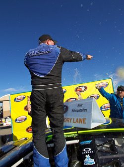 Victory lane: race winner Greg Pursley celebrates