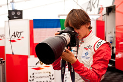 Esteban Gutierrez takes a photo with a large camera and lens