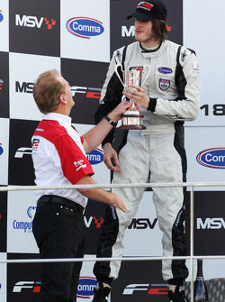 Race 1 second placed driver Will Bratt is presented with the trophy by Jonathan Palmer, CEO MotorSport Vision