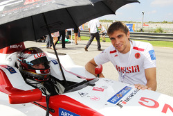 Vitaly Petrov Renault, on the grid with Ivan Samarin