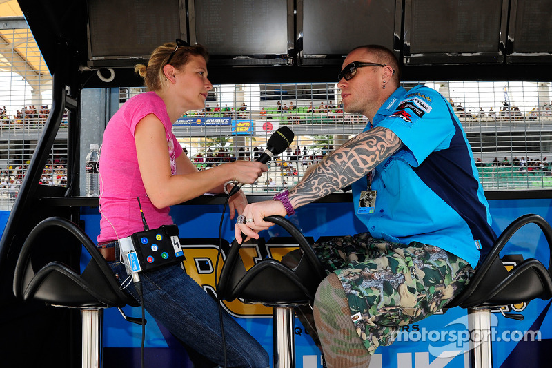 Keith Flint with Jenny Gow BBC at Malaysian GP