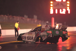 The body of Ashley Force Hood's Castrol GTX Mustang rests on the track after an explosion that sep