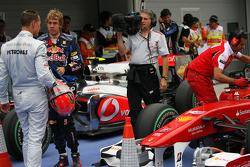 Pole winner Sebastian Vettel, Red Bull Racing and Michael Schumacher, Mercedes GP