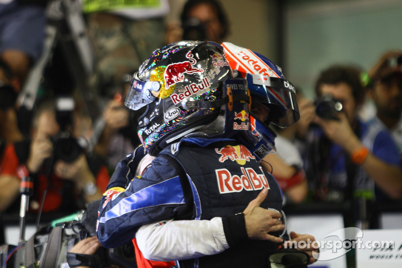 Race winner and 2010 Formula One World Champion Sebastian Vettel, Red Bull Racing, celebrates with Jenson Button, McLaren Mercedes
