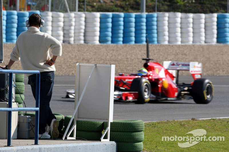 Michael Schumacher, Mercedes GP Petronas F1 watches Felipe Massa, Scuderia Ferrari