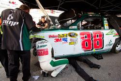 Dale Earnhardt Jr., Hendrick Motorsports Chevrolet helps his crew on his damaged car