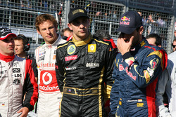The F1 drivers stand for a minute silence for Japan