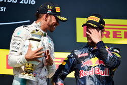 race winner Lewis Hamilton, Mercedes AMG F1 celebrates on the podium with third placed Daniel Ricciardo, Red Bull Racing