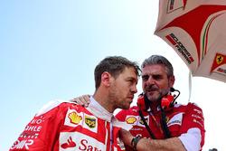 Sebastian Vettel, Ferrari with Maurizio Arrivabene, Ferrari Team Principal on the grid