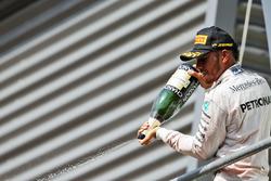Podium: Lewis Hamilton, Mercedes AMG F1 celebrates his third position with the champagne on the podium