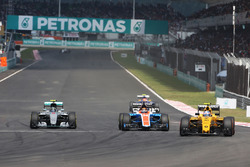 (L to R): Nico Rosberg, Mercedes AMG F1 W07 Hybrid, Pascal Wehrlein, Manor Racing MRT05, and Jolyon Palmer, Renault Sport F1 Team RS16, battle for position