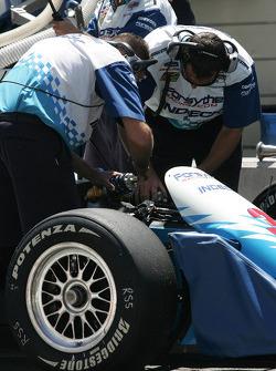 Mechanics work on Paul Tracy's car