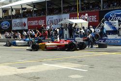 Sébastien Bourdais and Paul Tracy race at pit exit