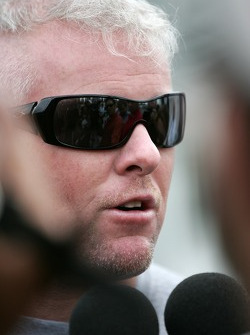Paul Tracy talks with the members of the local medias