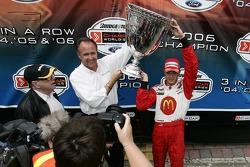 Champ Car World Series 2006 champion Sébastien Bourdais celebrates with the Vanderbilt Cup