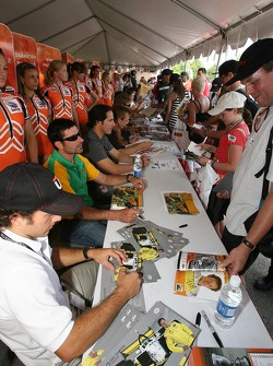 Fans meet drivers at the autograph session