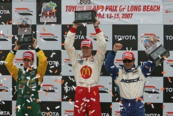 Podium: race winner Sébastien Bourdais celebrates with Oriol Servia and Will Power