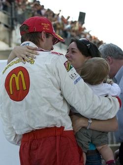 Race winner Sébastien Bourdais celebrates with wife Claire and daughter Emma