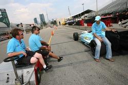 Graham Rahal discusses with Newman/Haas/Lanigan Racing crew members