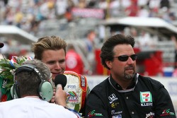 Dan Wheldon and Michael Andretti talk to Bob Jenkins during the victory laps