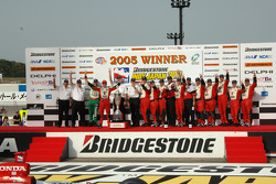Race winner Dan Wheldon celebrates with this team