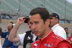 Helio Castroneves talks with the press after his qualifying run
