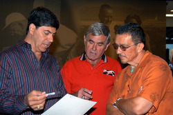 Al Unser, Sr. reviews opening remarks with Village of Los Ranchos de Albuquerque Mayor Larry Abraham and Administrator Juan Vigil