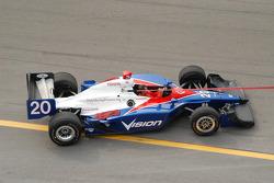Ed Carpenter's car being towed to pit lane