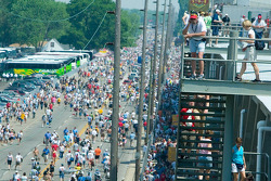 The large crowd on 16th Street make their way into the Speedway