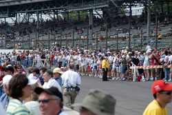 Fans crowd the track