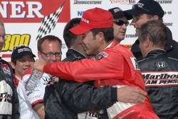 Victory lane: race winner Helio Castroneves celebrates