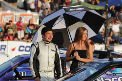 Walker Wilkerson with his umbrella girl during driver introduction