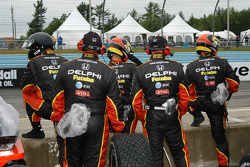 Delphi Fernandez team looks on