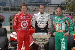 IndyCar Series 2007 Championship contenders Scott Dixon, Dario Franchitti and Tony Kanaan pose with the IndyCar Series trophy during a photo shoot on Navy Pier in Chicago