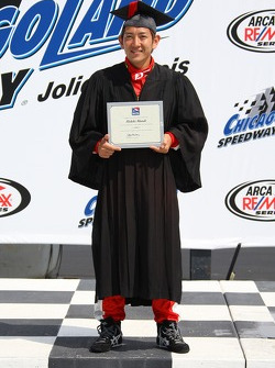 Hideki Mutoh receives a certificate from Roger Bailey as he moves in the IndyCar Series