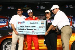 Pole winner Helio Castroneves accepts the pole award check