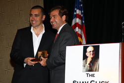 Dario Franchitti, left, receives his Champion of Champions winner's ring from IMS President and Chief Operating Officer Joie Chitwood at the Shav Glick Newsmakers Forum