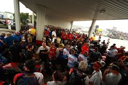 prostock motorcycle teams await the afternoon shower to pass unter the tower