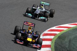 Sebastian Vettel, Red Bull Racing leads Nico Rosberg, Mercedes GP Petronas F1 Team