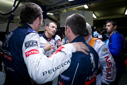 Provisional pole winner Stéphane Sarrazin celebrates with Franck Montagny and Nicolas Minassian