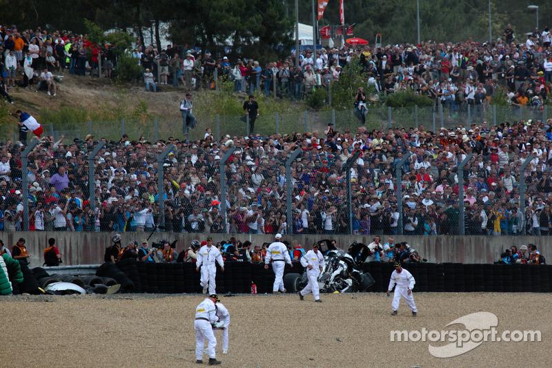 The scene after the crash of Allan McNish in the #3 Audi Sport North America Audi R18 TDI