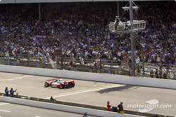 Helio Castroneves taking the checkered flag