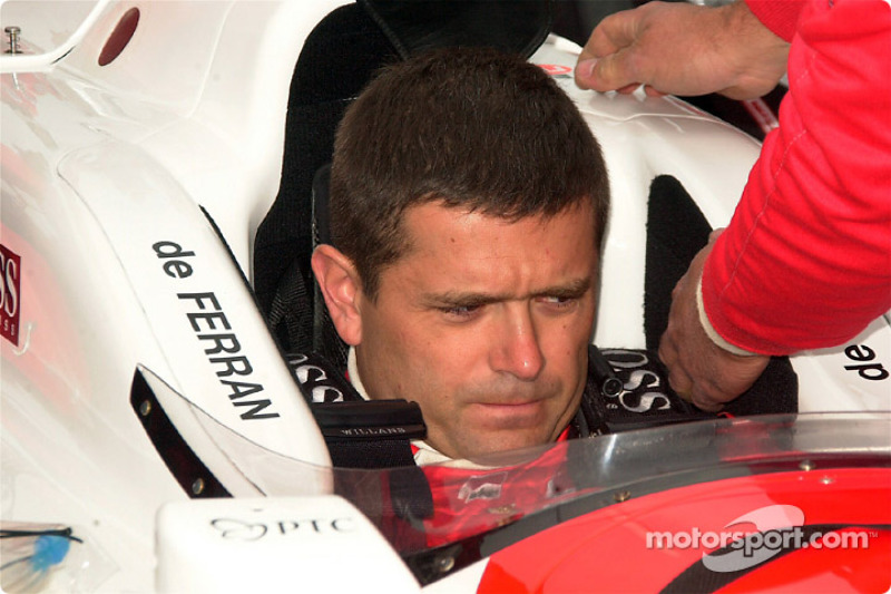 Gil de Ferran gets strapped in for the race
