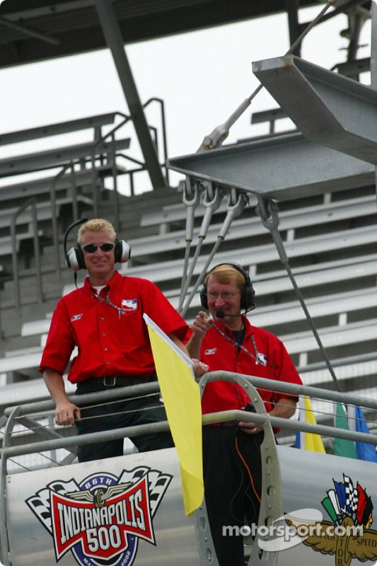 Paul Blevis and Jeff Boles waiving the yellow flag