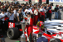 Dan Wheldon poses with the winner's trophy
