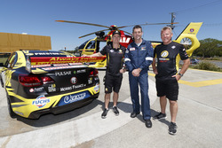 Lee Holdsworth, SLSQ chief pilot Paul Gibson and Team owner Charlie Schwerkolt supporting Surf Life Saving Queensland